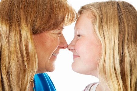 Pretty blond mother and daughter face off nose to nose.  Closeup. Stock Photo - Budget Royalty-Free & Subscription, Code: 400-04585458