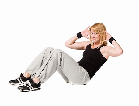 sweaty woman - Woman doing situps Stock Photo - Budget Royalty-Free & Subscription, Code: 400-04586764