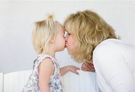 daughter kissing mother - Mother Giving Little Girl a Big Kiss Stock Photo - Budget Royalty-Free & Subscription, Code: 400-04587779