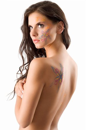 sensual brunette with a flower tattoo on her face and on her naked back Stock Photo - Budget Royalty-Free & Subscription, Code: 400-04588450