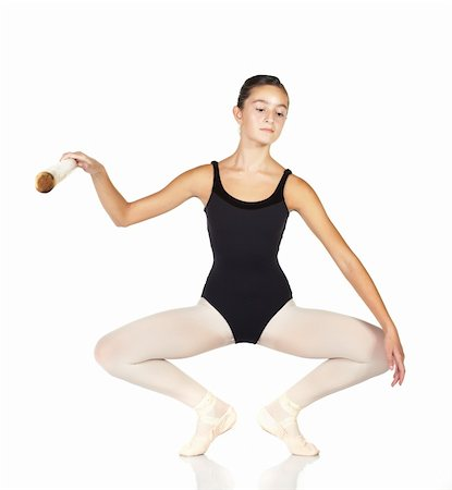 Young caucasian ballerina girl on white background and reflective white floor showing various ballet steps and positions. Full Plie in first Position.  Not Isolated. Stock Photo - Budget Royalty-Free & Subscription, Code: 400-04595108