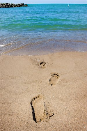 An image of footprints leading into the ocean Stock Photo - Budget Royalty-Free & Subscription, Code: 400-04595162