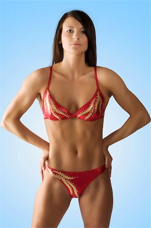 pretty woman with a muscular body in a plastic pose Stock Photo - Budget Royalty-Free & Subscription, Code: 400-04596915