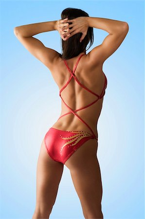 sexy girl in red costume showing her back side muscle Stock Photo - Budget Royalty-Free & Subscription, Code: 400-04596911