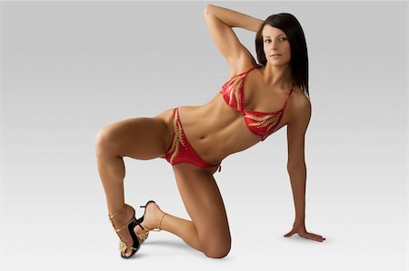 sexy brunette in swimwear taking body builder pose Stock Photo - Budget Royalty-Free & Subscription, Code: 400-04596920