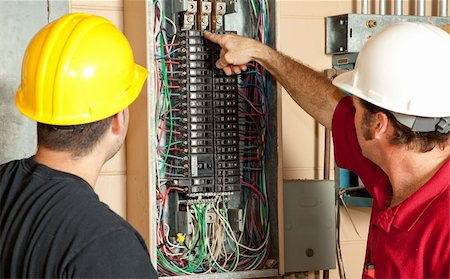 electrician fixing fuse box stock photos page 1 masterfile electrician fixing fuse box electricians identify a 20 amp breaker that has gone bad and