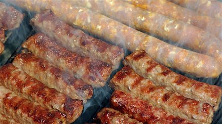 Grilled meat on the barbecue with smoke Stock Photo - Budget Royalty-Free & Subscription, Code: 400-04590881