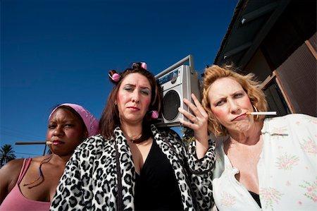 Portrait of three trashy women outdoors Stock Photo - Budget Royalty-Free & Subscription, Code: 400-04591310