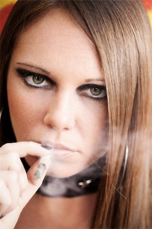 portrait of young female smoking a joint. Stock Photo - Budget Royalty-Free & Subscription, Code: 400-04604807