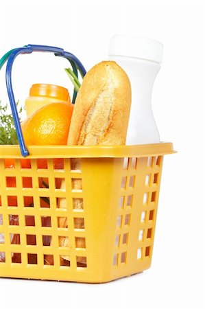 A shopping basket full of groceries isolated on white background Stock Photo - Budget Royalty-Free & Subscription, Code: 400-04605857