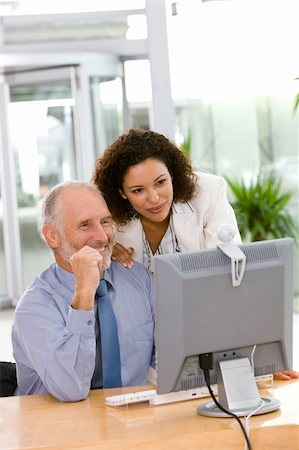 Confident business team working on computer Stock Photo - Budget Royalty-Free & Subscription, Code: 400-04606206