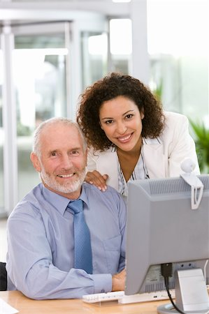 Confident business team working on computer Stock Photo - Budget Royalty-Free & Subscription, Code: 400-04606207