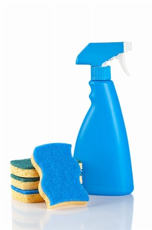 Plastic detergent spray bottle and sponges reflected on white background Stock Photo - Budget Royalty-Free & Subscription, Code: 400-04607534