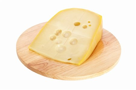 Slice of fresh cheese on wooden dish isolated Stock Photo - Budget Royalty-Free & Subscription, Code: 400-04607538