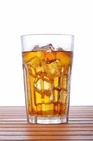 A glass of ice tea on wooden background. Shallow depth of field Stock Photo - Budget Royalty-Free & Subscription, Code: 400-04607547