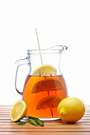 Ice tea pitcher with lemon and icecubes on wooden background Stock Photo - Budget Royalty-Free & Subscription, Code: 400-04607548