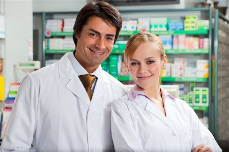 portrait of two pharmacists looking at camera and smiling Stock Photo - Budget Royalty-Free & Subscription, Code: 400-04601935