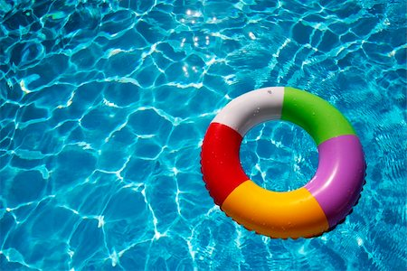 spanishalex (artist) - Inflatable Rubber Ring floating in a beautiful blue pool Stock Photo - Budget Royalty-Free & Subscription, Code: 400-04616213