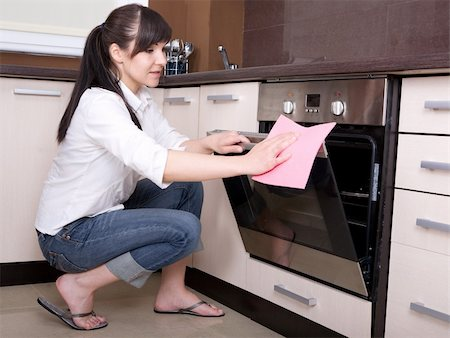 young brunette woman cleaning kitchen Stock Photo - Budget Royalty-Free & Subscription, Code: 400-04616861