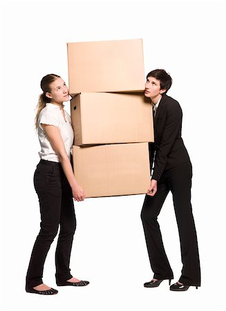 Two women carrying three boxes Stock Photo - Budget Royalty-Free & Subscription, Code: 400-04612195