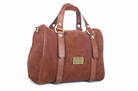 A brown handbag with soft shadow on white background Stock Photo - Budget Royalty-Free & Subscription, Code: 400-04613857