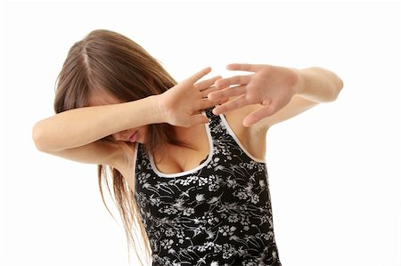 running away scared - Teen girl frighten, covering her face - abuse crime concept Stock Photo - Budget Royalty-Free & Subscription, Code: 400-04624849