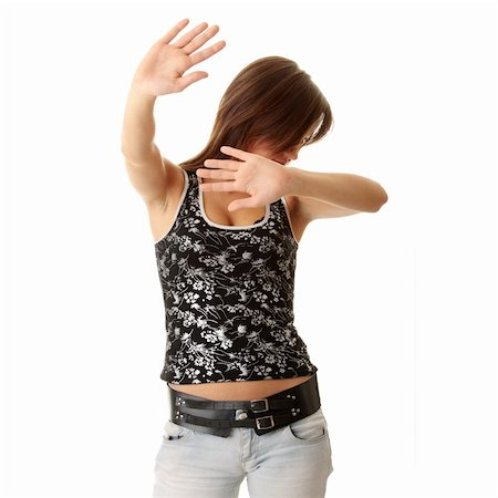 running away scared - Teen girl frighten, covering her face - abuse crime concept Stock Photo - Budget Royalty-Free & Subscription, Code: 400-04624850