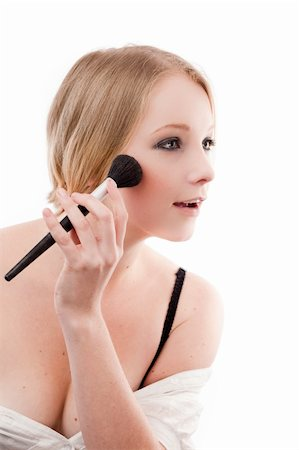 Young woman applies makeup with a soft brush beautiful skin Stock Photo - Budget Royalty-Free & Subscription, Code: 400-04625965