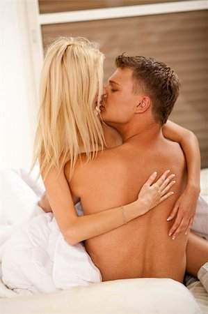 lovers kissing in bed Stock Photo - Budget Royalty-Free & Subscription, Code: 400-04627230