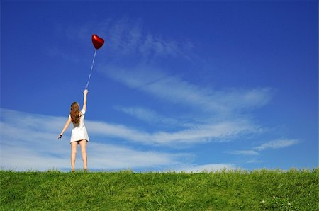 flying heart girl - girl with a red ball in the form of heart on the background of the sky Stock Photo - Budget Royalty-Free & Subscription, Code: 400-04629612