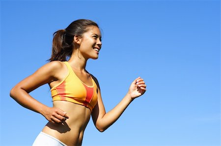 Sporty woman runner in profile on a hot summer day. A lot of copy space. Stock Photo - Budget Royalty-Free & Subscription, Code: 400-04629620