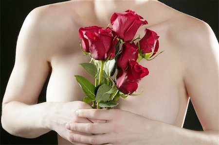 Romantic nude woman in love holding red roses in hands Stock Photo - Budget Royalty-Free & Subscription, Code: 400-04629955