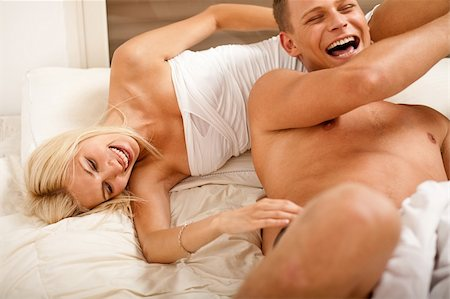 Couple playing bedroom games Stock Photo - Budget Royalty-Free & Subscription, Code: 400-04621228