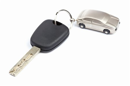Car key isolated on white background with shallow depth of field Stock Photo - Budget Royalty-Free & Subscription, Code: 400-04621378