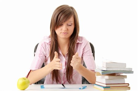 Teenage girl studying with textbooks looking unhappy Stock Photo - Budget Royalty-Free & Subscription, Code: 400-04622035
