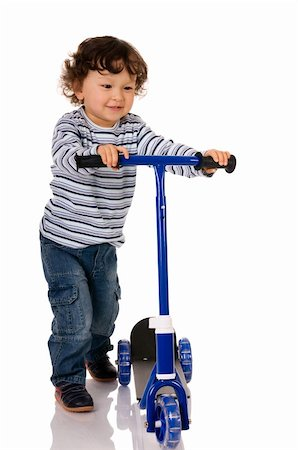 sports scooters - little boy riding scooter Stock Photo - Budget Royalty-Free & Subscription, Code: 400-04638236