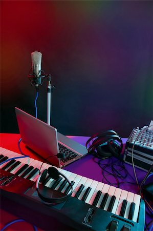 Microphone in the night colorful light in a recording studio Stock Photo - Budget Royalty-Free & Subscription, Code: 400-04630784