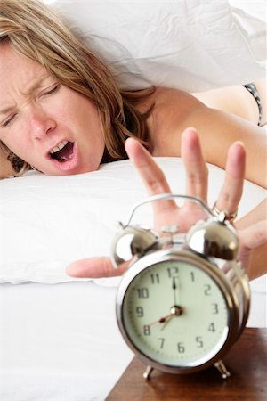 spanishalex (artist) - Woman waking up late and reaching for her alarm clock Stock Photo - Budget Royalty-Free & Subscription, Code: 400-04631118