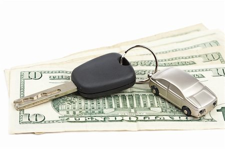 Car key and dollar bills on white background with shallow depth of field Stock Photo - Budget Royalty-Free & Subscription, Code: 400-04646035