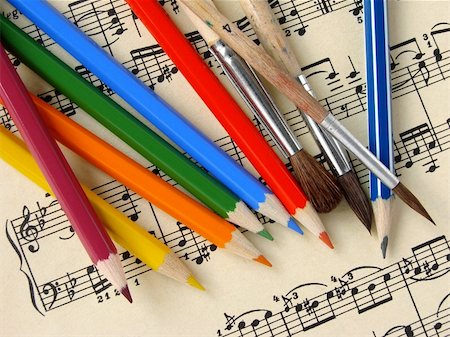 color pencils and paintbrushes on the musical notes background Stock Photo - Budget Royalty-Free & Subscription, Code: 400-04640260