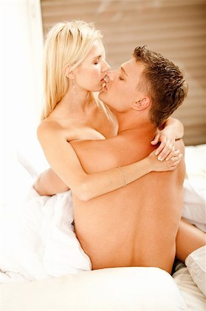 Young passionate couple embracing and kissing Stock Photo - Budget Royalty-Free & Subscription, Code: 400-04642412