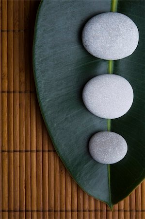 spanishalex (artist) - Spa Pebbles and leaves on a bamboo mat Stock Photo - Budget Royalty-Free & Subscription, Code: 400-04643443