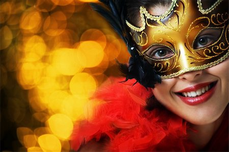 Beautiful young woman in carnival mask over gold background Stock Photo - Budget Royalty-Free & Subscription, Code: 400-04654972