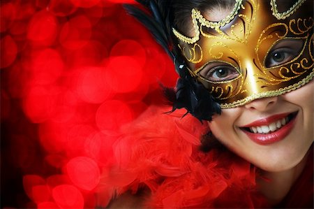 Beautiful young woman in carnival mask over red background Stock Photo - Budget Royalty-Free & Subscription, Code: 400-04654973
