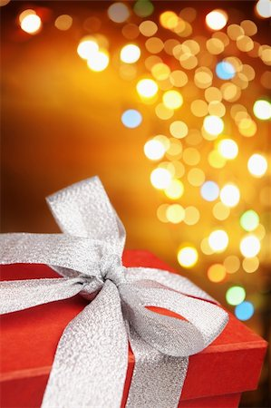 silver box - Christmas present with colorful blurred lamp on background Stock Photo - Budget Royalty-Free & Subscription, Code: 400-04657924