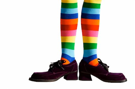 stocking feet - Wacky clown feet with crazy striped socks and oversized purple suede shoes!  Isolated. Stock Photo - Budget Royalty-Free & Subscription, Code: 400-04658893