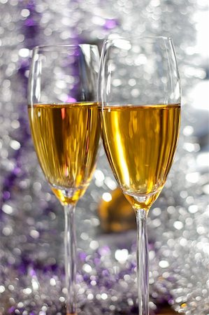 silver box - Two glasses of champagne on beautiful bokeh background Stock Photo - Budget Royalty-Free & Subscription, Code: 400-04659526