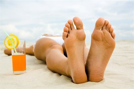 pressmaster - Close-up of two human feet on sandy beach with cocktail near by Stock Photo - Budget Royalty-Free & Subscription, Code: 400-04650480