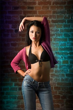 fashion shot of cute and sexy chinese girl with black bra and purple jacket near a brick wall Stock Photo - Budget Royalty-Free & Subscription, Code: 400-04651392