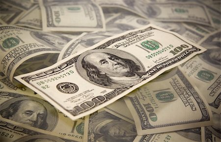 One hundred dollar bill on a heap of bills Stock Photo - Budget Royalty-Free & Subscription, Code: 400-04652540